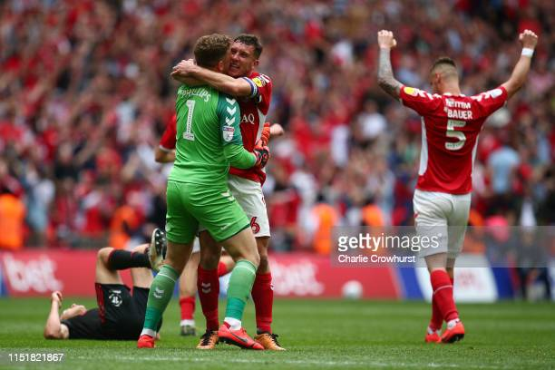 Dillon Phillips Patrick Bauer and Jason Pearce of Charlton Athletic celebrate victory at the final whistle during the Sky Bet League One Playoff...