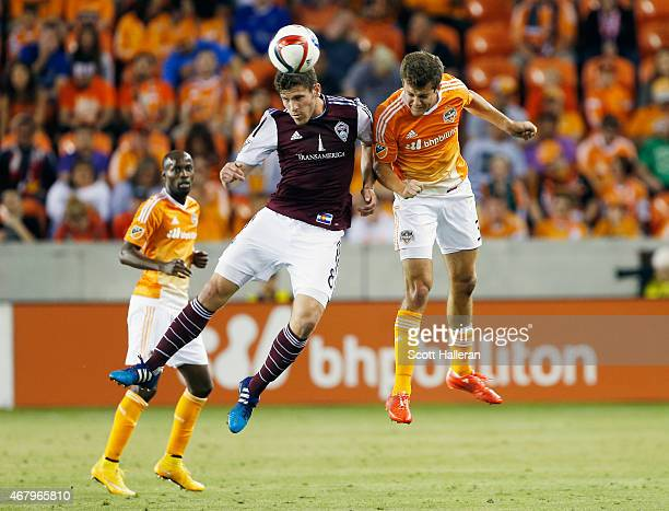 Dillon Powers of the Colorado Rapids battles for the ball with Rob Lovejoy of the Houston Dynamo during their game at BBVA Compass Stadium on March...