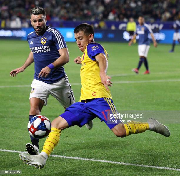 Dillon Serna of the Colorado Rapids clears the ball against Romain Alessandrini of the Los Angeles Galaxy during the second half at Dignity Health...