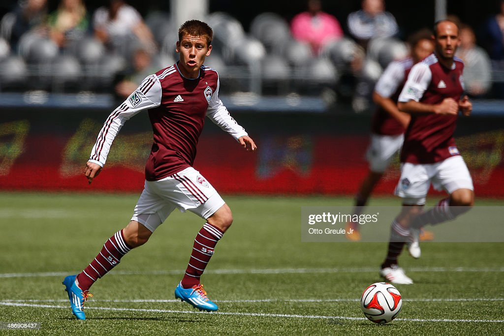 Dillon Serna #17 of the Colorado Rapids dribbles against the Seattle Sounders FC at CenturyLink Field on April 26, 2014 in Seattle, Washington. The Sounders defeated the Rapids 4-1.
