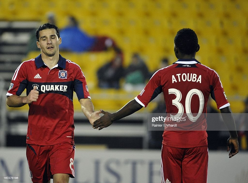 Dilly Duka #8 of the Chicago Fire is congratulated by teammate Yazid Atouba #30 during the second half of a game against the Vancouver Whitecaps FC at Blackbaud Stadium on February 23, 2013 in Charleston, South Carolina.