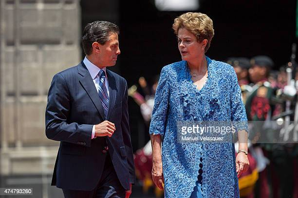 Dilma Rousseff President of Brazil and Enrique Peña Nieto President of Mexico talk during an official reception ceremony at Palacio Nacional on May...