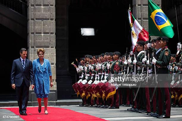 Dilma Rousseff President of Brazil walks nex to Enrique Peña Nieto President of Mexico during an official reception ceremony at Palacio Nacional on...