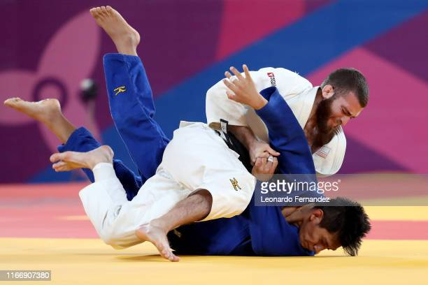 Dilmer Calle of Peru competes against Adonis Diaz of United States during the Judo Men's -60 kg Bronze Medals on Day 13 of Lima 2019 Pan American...