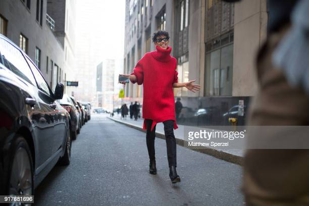 Dilone is seen on the street attending OSCAR DE LA RENTA during New York Fashion Week wearing an oversized red sweater and black pants on February 12...