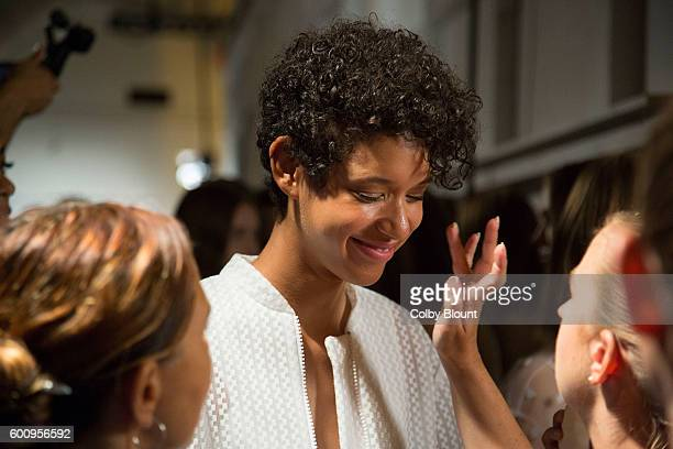 Dilone prepares backstage at Noon by Noor fashion show during New York Fashion Week The Gallery Skylight at Clarkson Sq on September 8 2016 in New...