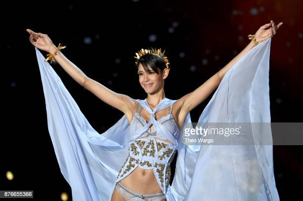 Dilone walks the runway during the 2017 Victoria's Secret Fashion Show In Shanghai at MercedesBenz Arena on November 20 2017 in Shanghai China