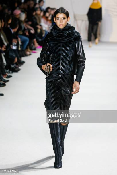 Dilone walks the runway during the Akris show as part of the Paris Fashion Week Womenswear Fall/Winter 2018/2019 on March 4 2018 in Paris France