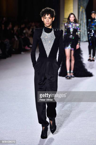 Dilone walks the runway during the Balmain show as part of the Paris Fashion Week Womenswear Fall/Winter 2018/2019 on March 2 2018 in Paris France