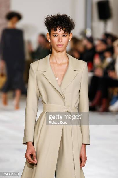 Dilone walks the runway during the Jacquemus show at Petit Palais as part of the Paris Fashion Week Womenswear Fall/Winter 2018/2019 on February 26...
