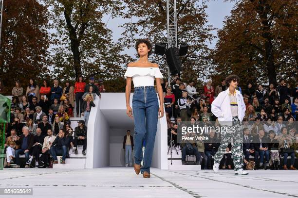Dilone walks the runway during the Lacoste show as part of the Paris Fashion Week Womenswear Spring/Summer 2018 on September 27 2017 in Paris France