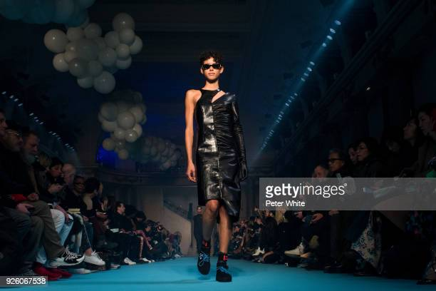 Dilone walks the runway during the OffWhite show as part of the Paris Fashion Week Womenswear Fall/Winter 2018/2019 on March 1 2018 in Paris France