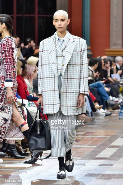 Dilone walks the runway during the Thom Browne show as part of the Paris Fashion Week Womenswear Fall/Winter 2019/2020 on March 03 2019 in Paris...