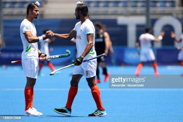 Dilpreet Singh and Hardik Singh of Team India celebrate after defeating Team New Zealand 3-2 during the Men's Pool A match on day one of the Tokyo...