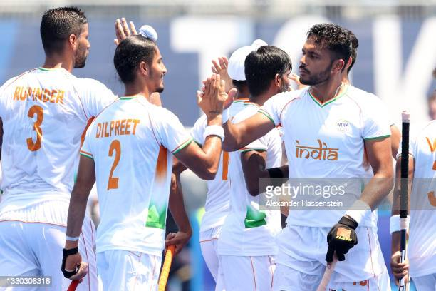 Dilpreet Singh and Harmanpreet Singh of Team India celebrate scoring during the Men's Pool A match against Team New Zealand on day one of the Tokyo...