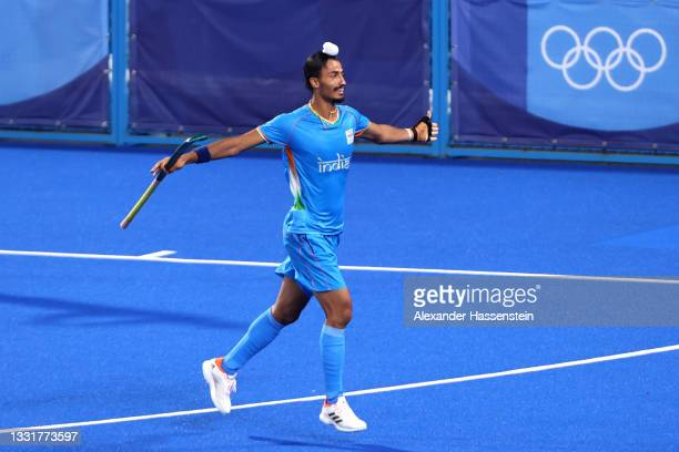Dilpreet Singh of Team India celebrates after scoring their team's first goal during the Men's Quarterfinal match between India and Great Britain on...