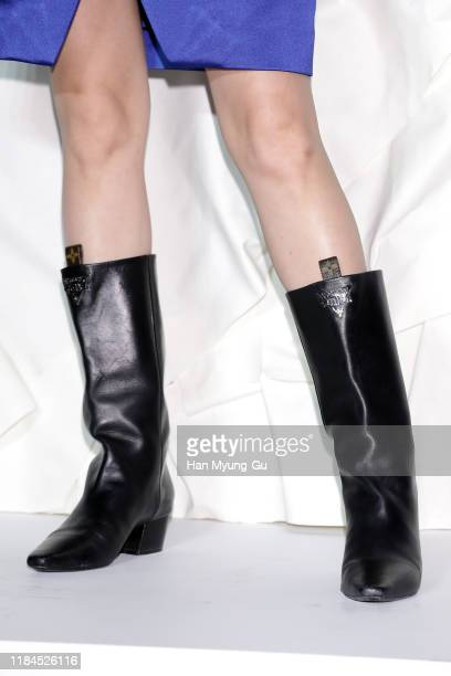 Dilraba Dilmurat shoe detail attends the photocall for 'Louis Vuitton Maison Seoul' opening party on October 30 2019 in Seoul South Korea