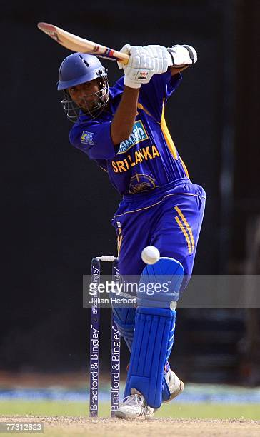 Dilruwan Perera of Sri Lanka attacks the bowling of James Anderson during the 5th One Day International between Sri Lanka and England played at The...