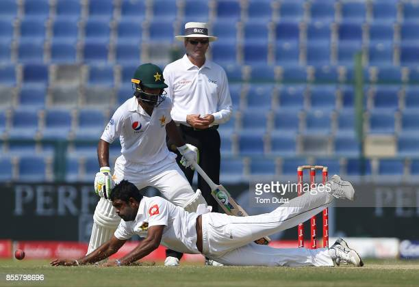 Dilruwan Perera of Sri Lanka attempts to catch the ball during Day Three of the First Test between Pakistan and Sri Lanka at Sheikh Zayed Stadium on...