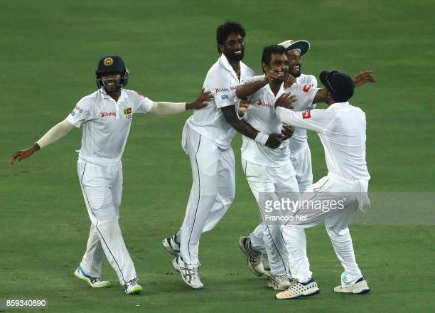 Dilruwan Perera of Sri Lanka celebrate with teammates after dismissing Shan Masood of Pakistan during Day Four of the Second Test between Pakistan...