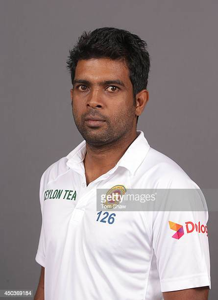 Dilruwan Perera of Sri Lanka poses for a headshot during the Sri Lanka portrait session at Lord's Cricket Ground on June 10 2014 in London England