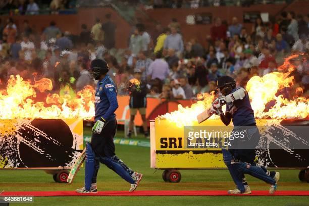 Dilshan Munaweera and Upul Tharanga of Sri Lanka walk out to bat during the International Twenty20 match between Australia and Sri Lanka at Adelaide...
