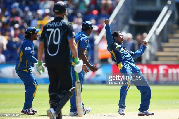 Dilshan Tilakarathne of Sri Lanka celebrates capturing the wicket of James Franklin of New Zealand fields during the Group A ICC Champions Trophy...