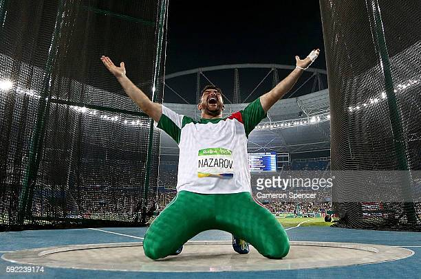 Dilshod Nazarov of Tajikistan celebrates during the Men's Hammer Throw Final on Day 14 of the Rio 2016 Olympic Games at the Olympic Stadium on August...