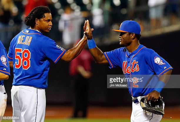 Dilson Herrera and Jenrry Mejia of the New York Mets celebrate after defeating the Philadelphia Phillies at Citi Field on August 29 2014 in the...