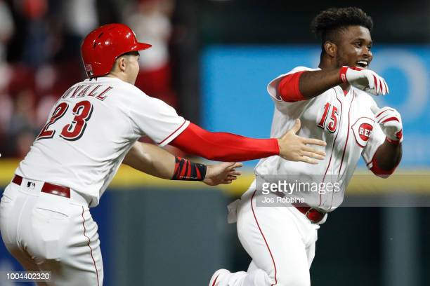 Dilson Herrera of the Cincinnati Reds celebrates after hitting a gamewinning single in the ninth inning against the St Louis Cardinals during a game...