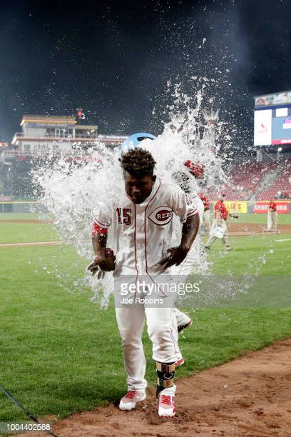 Dilson Herrera of the Cincinnati Reds is doused with water after hitting a gamewinning single in the ninth inning against the St Louis Cardinals...