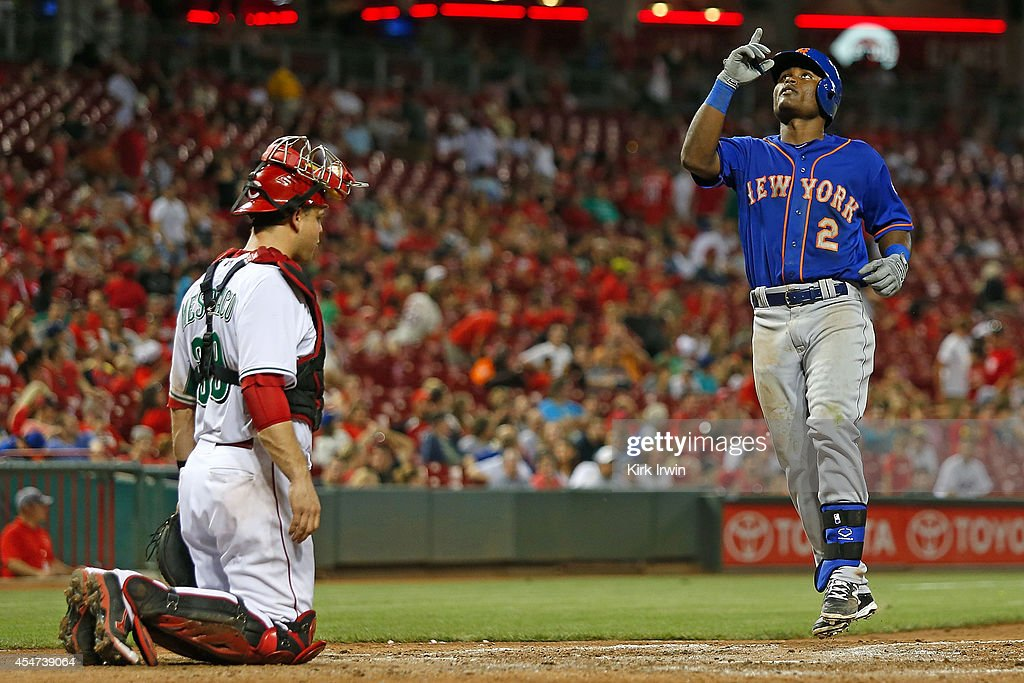 Dilson Herrera #2 of the New York Mets celebrates hitting a home run as he crosses the plate in front of Devin Mesoraco #39 of the Cincinnati Reds during the eighth inning at Great American Ball Park on September 5, 2014 in Cincinnati, Ohio. New York defeated Cincinnati 14-5.