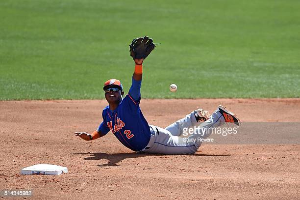 Dilson Herrera of the New York Mets flips a ball to second base during the second inning of a spring training game against the Atlanta Braves at...