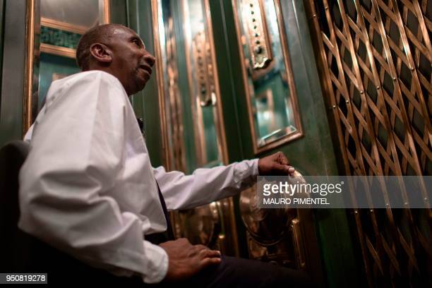 Dilson Lopes Santana elevator attendant operates a lift at the Bank of Brazil Cultural Centre in downtown Rio de Janeiro Brazil on April 18 2018...