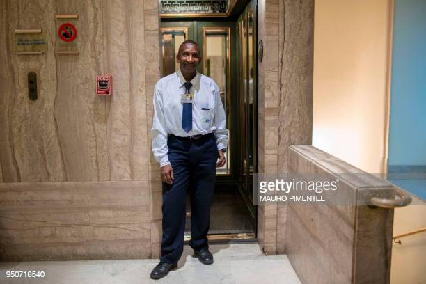Dilson Lopes Santana elevator attendant poses for pictures at the Bank of Brazil Cultural Centre in downtown Rio de Janeiro Brazil on April 18 2018...