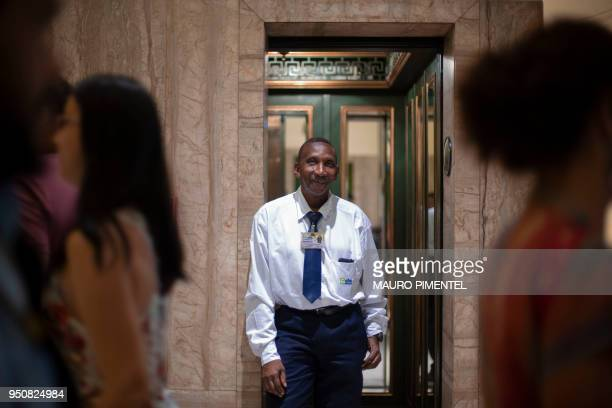 Dilson Lopes Santana elevator operator poses for pictures at the Bank of Brazil Cultural Centre in downtown Rio de Janeiro Brazil on April 18 2018...