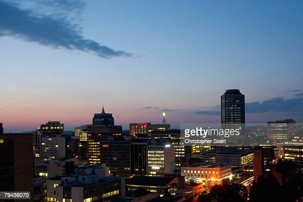 Dim night lights of Harare's CBD attest to the crippling effect of power shortages experienced daily by Zimbabwean. Harare, Mashonaland, Zimbabwe, Africa