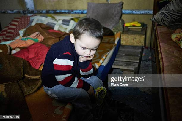 Dima 3 years old lives in a basement with her mother as many inhabitants of a northern suburb of Donetsk find shelter underground living under the...