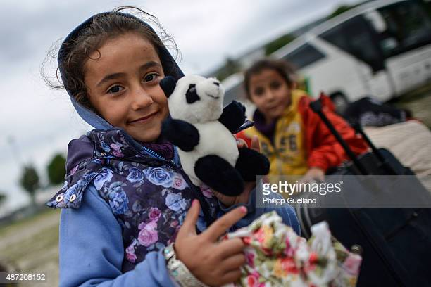 Dima from Syria shows a toy panda at a refugee accomodation facility outside an exhibition hall on September 7 2015 in Munich Germany German...