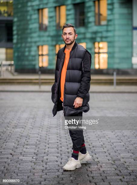 Dima wearing Gucci sneakers Gucci socks orange Supreme tshirt Rick Owens college jacket and Rick Owens down feather vest black Rick Owens pants on...