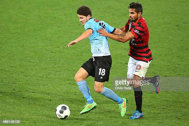 Dimas Delgado of the Wanderers and Roman Hofmann of the Sharks compete for the ball during the FFA Cup Round of 16 match between Palm Beach Sharks...