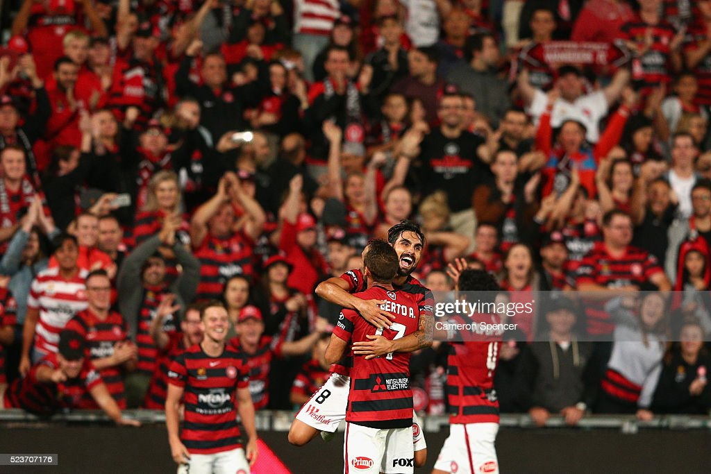 Dimas Delgado of the Wanderers celebrates with team mate Alberto Aguilar after winning the A-League Semi Final match in extra time between the Western Sydney Wanderers and the Brisbane Roar at Pirtek Stadium on April 24, 2016 in Sydney, Australia.
