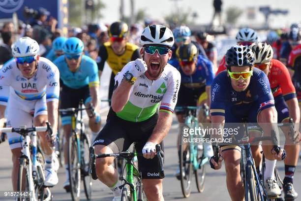 Dimension Data's British rider Mark Cavendish celebrates his victory as he crosses the finish line during the third stage of the Dubai Tour, from Sky...
