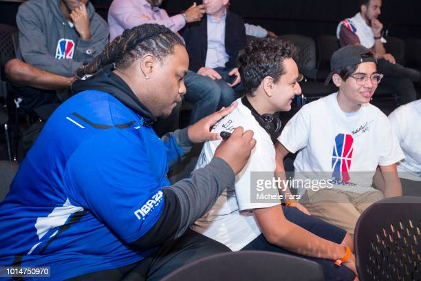 Dimez of Mavs Gaming autographs the shirt of a fan during Week 12 of the NBA 2K League on August 10 2018 at the NBA 2K Studio in Long Island City New...