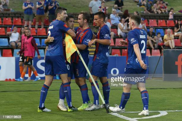 Dimi Petratos of the Newcastle Jets celebrates with team mates after scoring a goal during the round 12 A-League match between the Newcastle Jets and...