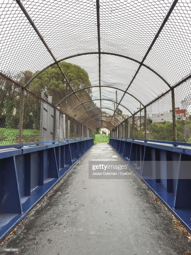 Diminishing Perspective Of Covered Bridge : Stock Photo