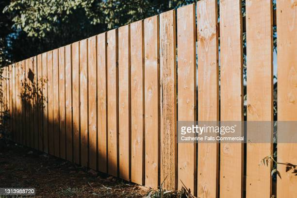 diminishing perspective of fence panels - wood material stock pictures, royalty-free photos & images