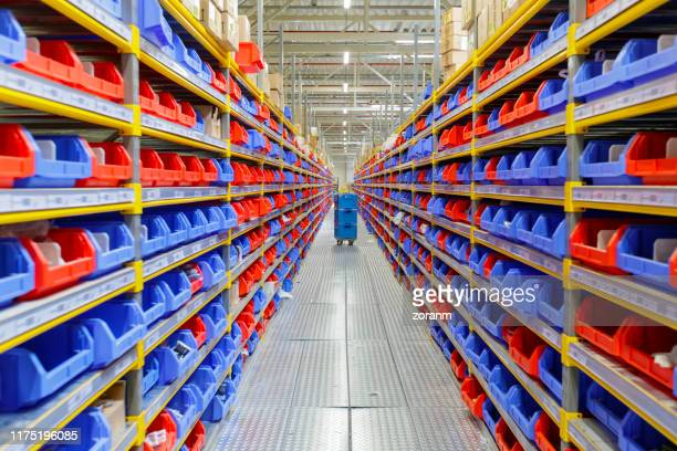 diminishing perspective of warehouse - industrial storage bins stock pictures, royalty-free photos & images