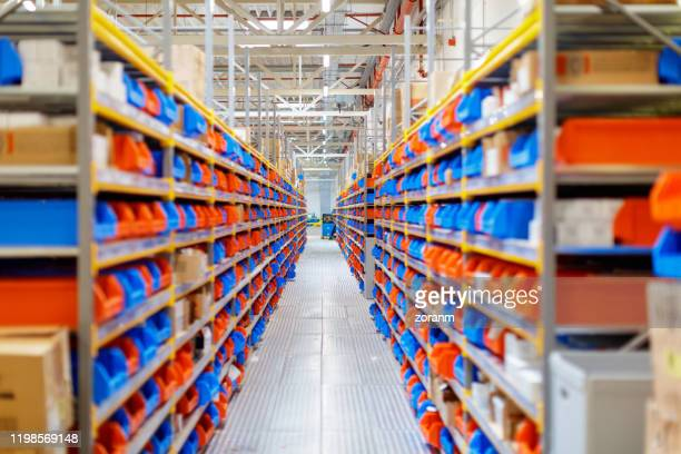 diminishing perspective of warehouse racks - industrial storage bins stock pictures, royalty-free photos & images