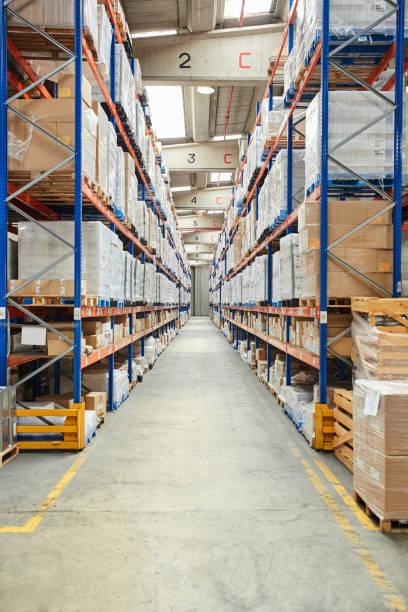 Diminishing View Of Aisle At Warehouse